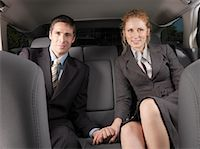 Man and Woman Holding Hands in Back of Car    Stock Photo - Premium Royalty-Freenull, Code: 600-01173939