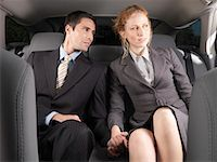 Man and Woman Holding Hands in Back of Car    Stock Photo - Premium Royalty-Freenull, Code: 600-01173940