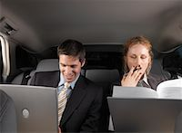 Businesspeople Working in Back of Car    Stock Photo - Premium Royalty-Freenull, Code: 600-01173944