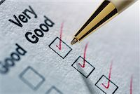 Close-Up of Pen Making Check Marks on Survey    Stock Photo - Premium Rights-Managednull, Code: 700-01183077