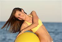 Girl at Beach with Exercise Ball    Stock Photo - Premium Rights-Managednull, Code: 700-01183756