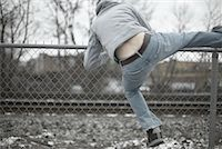 running away scared - Man Climbing over Fence    Stock Photo - Premium Royalty-Freenull, Code: 600-01184408