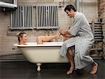 Man Massaging Woman's Foot