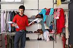 Man deciding what to Wear    Stock Photo - Premium Rights-Managed, Artist: Masterfile, Code: 700-01185167