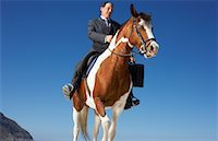 Businessman Riding Horse    Stock Photo - Premium Rights-Managednull, Code: 700-01185196
