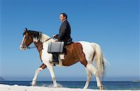 Businessman Riding Horse to Work    Stock Photo - Premium Rights-Managednull, Code: 700-01185198