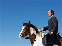 Businessman Riding Horse to Work    Stock Photo - Premium Rights-Managednull, Code: 700-01185199