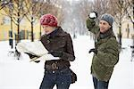 Man Sneaking up on Woman with Snowball    Stock Photo - Premium Rights-Managed, Artist: Masterfile, Code: 700-01185268