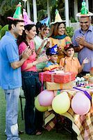 Group of people celebrating a birthday party Stock Photo - Premium Royalty-Freenull, Code: 630-01192703