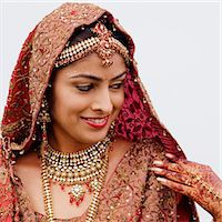 Close-up of a bride in a traditional wedding dress Stock Photo - Premium Royalty-Freenull, Code: 630-01192910