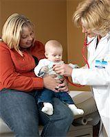 Doctor Examining Baby    Stock Photo - Premium Royalty-Freenull, Code: 600-01195065
