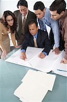 supervising - Business People Looking at Blueprints    Stock Photo - Premium Royalty-Freenull, Code: 600-01195300