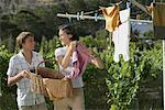 Mother and Son Hanging Laundry Outdoors    Stock Photo - Premium Rights-Managed, Artist: Masterfile, Code: 700-01195352