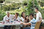 Family Eating Outdoors    Stock Photo - Premium Rights-Managed, Artist: Masterfile, Code: 700-01195364