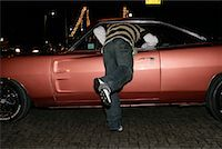 Man Reaching Into Car    Stock Photo - Premium Rights-Managednull, Code: 700-01196070