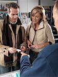 Salesman Assisting Customers    Stock Photo - Premium Royalty-Free, Artist: Masterfile, Code: 600-01198770
