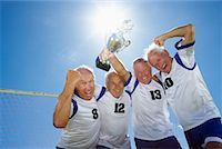 special moment - Soccer Players With Trophy    Stock Photo - Premium Rights-Managednull, Code: 700-01199276