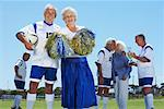 Soccer Players and Cheerleader on Soccer Pitch Stock Photo - Premium Rights-Managed, Artist: Masterfile, Code: 700-01199278