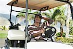 Man in Golf Cart    Stock Photo - Premium Rights-Managed, Artist: Masterfile, Code: 700-01199612
