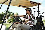 Man in Golf Cart    Stock Photo - Premium Rights-Managed, Artist: Masterfile, Code: 700-01199613