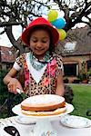 Girl with Cake in Backyard