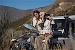 Couple Sitting on Jeep    Stock Photo - Premium Rights-Managed, Artist: Masterfile, Code: 700-01199881