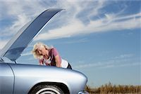 stalled car - Woman Looking Under Hood of Stalled Car    Stock Photo - Premium Rights-Managednull, Code: 700-01199946