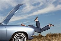stalled car - Woman Looking Under Hood of Stalled Car    Stock Photo - Premium Rights-Managednull, Code: 700-01199948