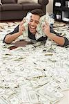 Man Lying on Pile of Money    Stock Photo - Premium Rights-Managed, Artist: Jerzyworks, Code: 700-01200198