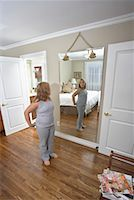 Girl Looking in Mirror    Stock Photo - Premium Rights-Managednull, Code: 700-01200266