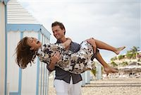 Man Carrying Woman at Beach    Stock Photo - Premium Rights-Managednull, Code: 700-01200435