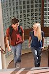Teenage couple walking up stairs Stock Photo - Premium Royalty-Free, Artist: Masterfile, Code: 621-01201172