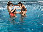 Family playing in pool Stock Photo - Premium Royalty-Freenull, Code: 621-01202458