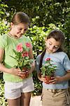 Girls with potted flowers Stock Photo - Premium Royalty-Free, Artist: Kevin Dodge, Code: 604-01222990