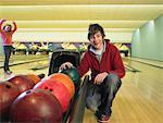Boy and Girl at Bowling Alley    Stock Photo - Premium Rights-Managed, Artist: Masterfile, Code: 700-01223403