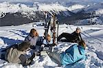 Group of People Relaxing at Top of Ski Hill, Whistler, BC, Canada