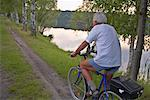 Man Cycling by Lake, Hannover, Germany    Stock Photo - Premium Rights-Managed, Artist: Mike Randolph, Code: 700-01224333
