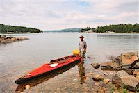 Man Standing Beside Kayak, Georgian Bay, Ontario, Canada    Stock Photo - Premium Rights-Managednull, Code: 700-01224357