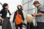 Designers Discussing Outfit    Stock Photo - Premium Royalty-Free, Artist: Masterfile, Code: 600-01224434