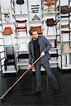Man Sweeping Up in Furniture Store    Stock Photo - Premium Royalty-Free, Artist: Masterfile, Code: 600-01224441