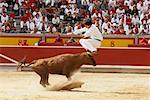 French Style Bullfighter Jumping Over Bull, Fiesta de San Fermin, Pamplona, Spain    Stock Photo - Premium Rights-Managed, Artist: Mike Randolph, Code: 700-01224403