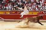 French Style Bullfighter Jumping Over Bull, Fiesta de San Fermin, Pamplona, Spain    Stock Photo - Premium Rights-Managed, Artist: Mike Randolph, Code: 700-01224404