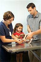 preteen girl feet - Father and daughter with dog at vet Stock Photo - Premium Royalty-Freenull, Code: 604-01232288