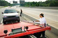 Tow truck driver loading car Stock Photo - Premium Royalty-Freenull, Code: 604-01233122