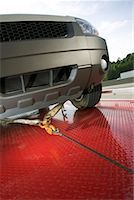 Car on tow truck Stock Photo - Premium Royalty-Freenull, Code: 604-01233221