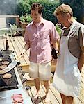 Men Barbequing    Stock Photo - Premium Rights-Managed, Artist: Masterfile, Code: 700-01234751