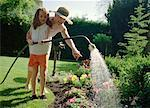 Grandmother and Granddaughter Watering Plants    Stock Photo - Premium Rights-Managed, Artist: Masterfile, Code: 700-01234769