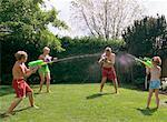 Family Having Water Fight    Stock Photo - Premium Rights-Managed, Artist: Masterfile, Code: 700-01234779
