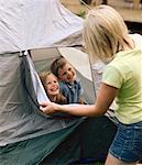Mother Looking at Children in Tent    Stock Photo - Premium Rights-Managed, Artist: Masterfile, Code: 700-01234797