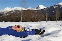 Man Lying in Snow    Stock Photo - Premium Royalty-Freenull, Code: 600-01235202